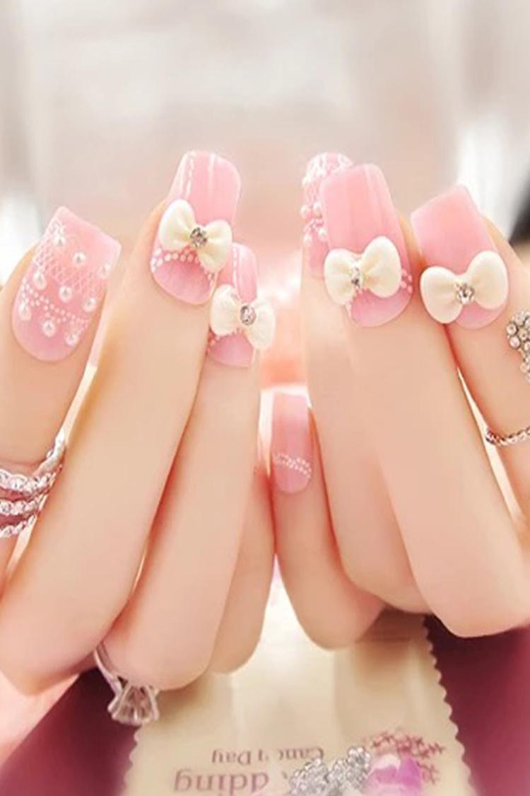白蝴蝶结粉色美甲,上手很唯美哦~24片左右哦~~送胶水呢