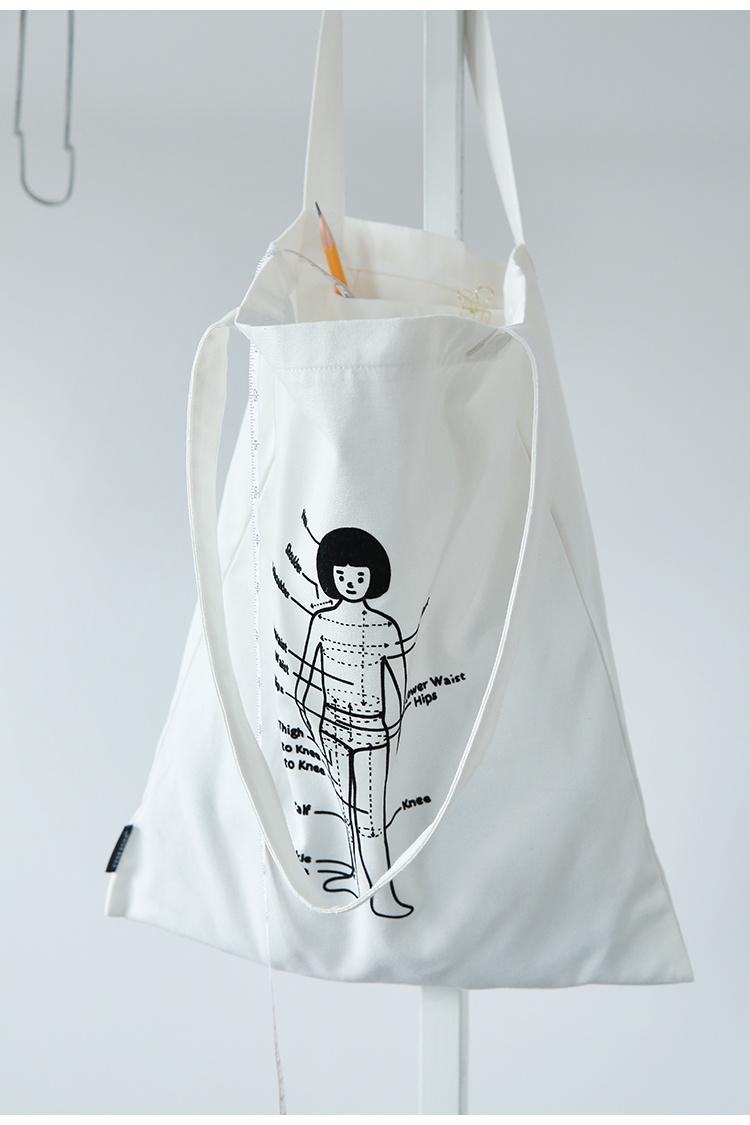 日系新款童趣字母小人白色帆布包