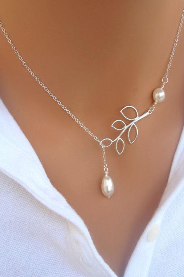 欧美风树叶水滴珍珠项链 产品参数 是否多层:否 是否镶嵌:未镶嵌 形状
